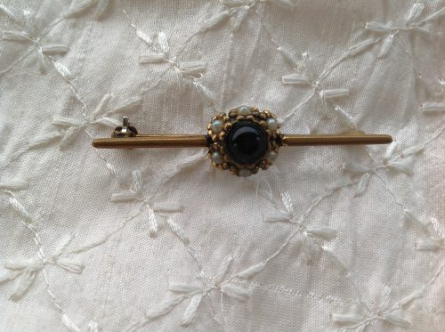 Vintage gold tone and black stone surrounded by faux seed pearls stock pin