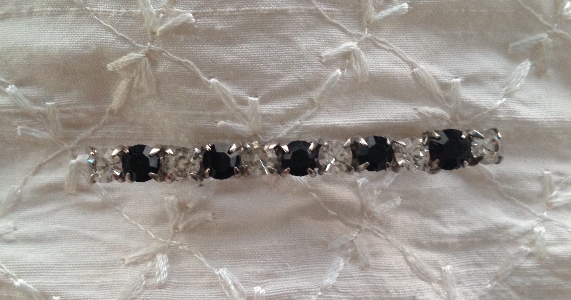 Vintage alternating clear and black crystal stock pin