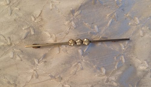Vintage silvertone and triple clear paste stock pin
