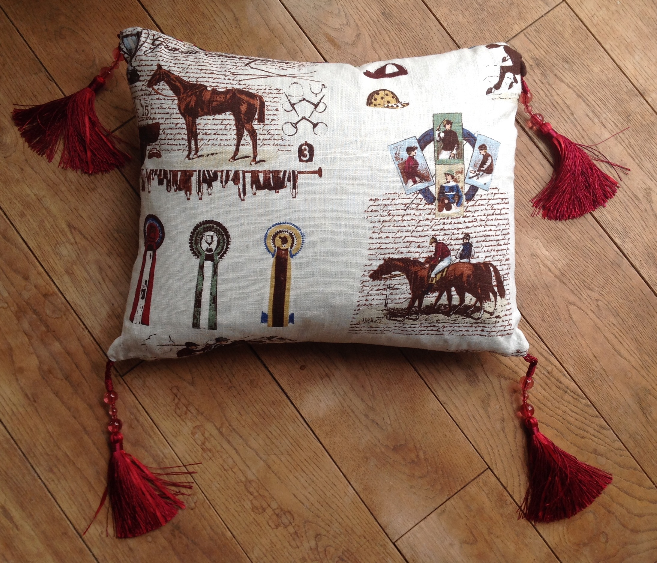 """Cushion cover - 13"""" x 17"""" Caballo sepia print with striped back and cranberry silk and bead tassles"""