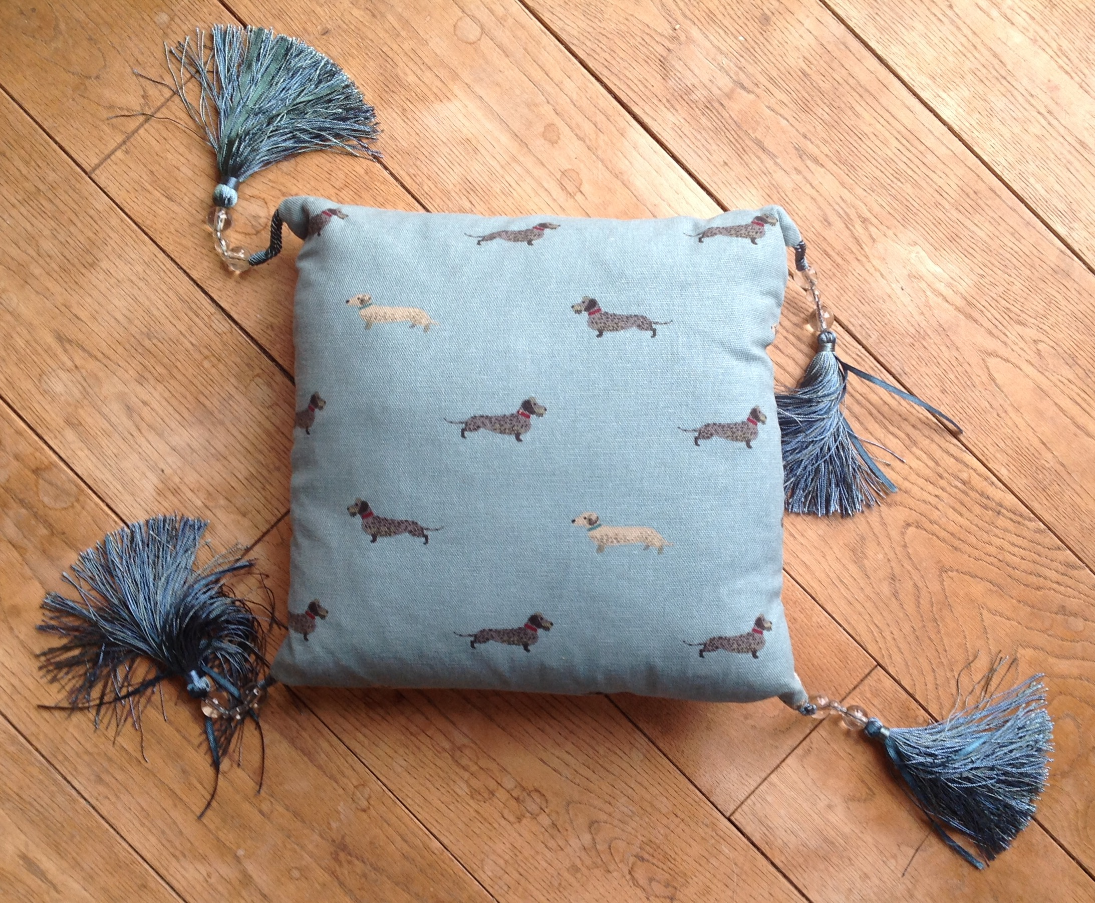 """Cushion cover -12"""" Wire haired daschunds on duck egg blue background and teal silk and bead tassles"""
