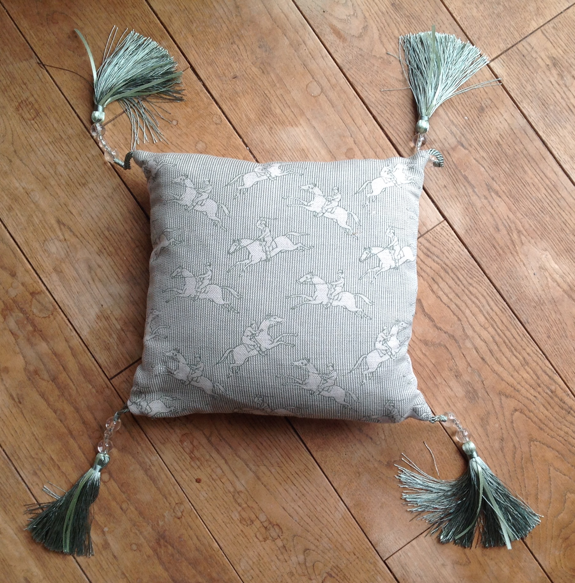 "Cushion cover - 12"" jumping horses with eau de nil silk and bead tassles"