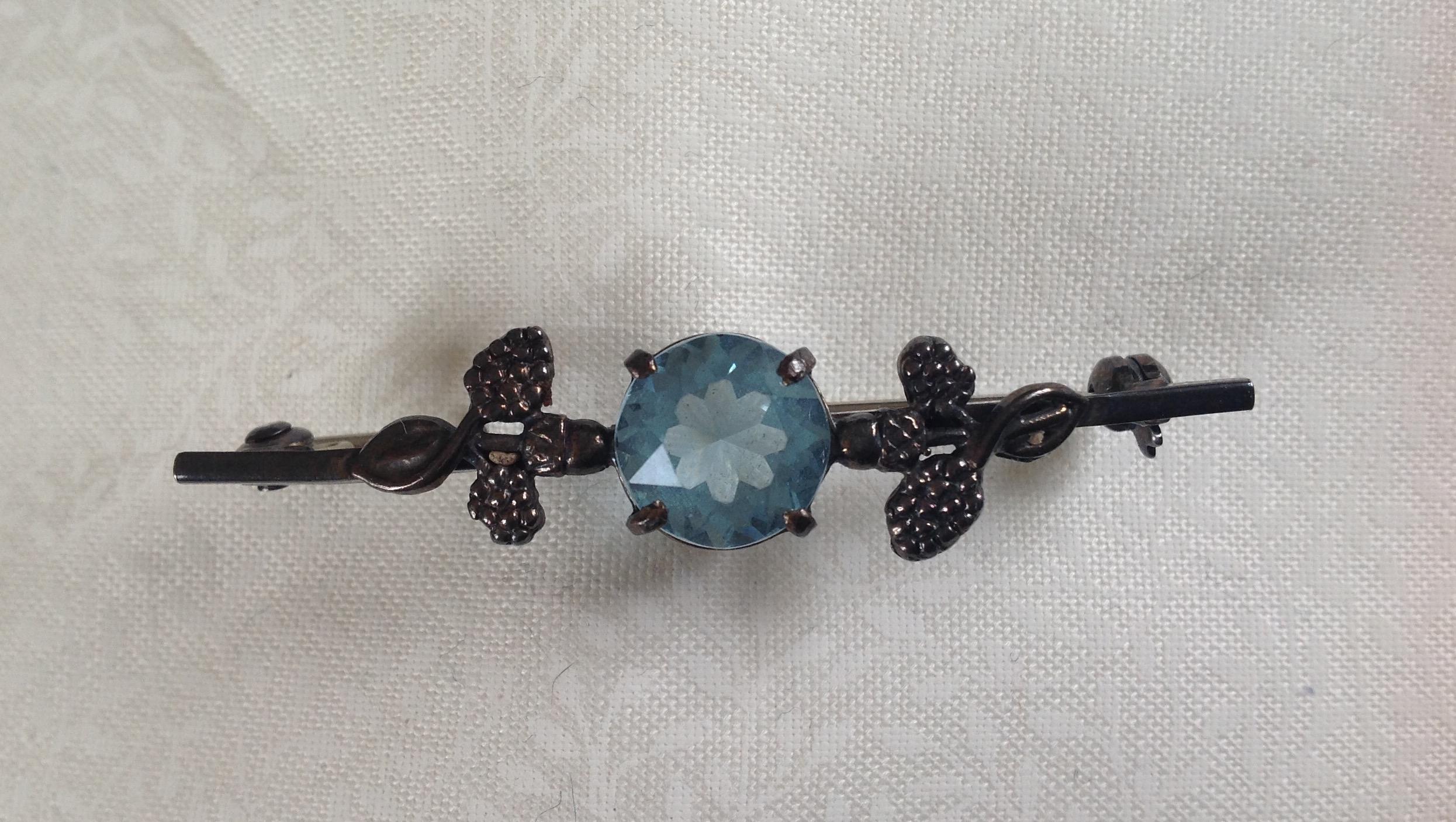 Vintage Art Nouveau silver and blue topaz stock pin