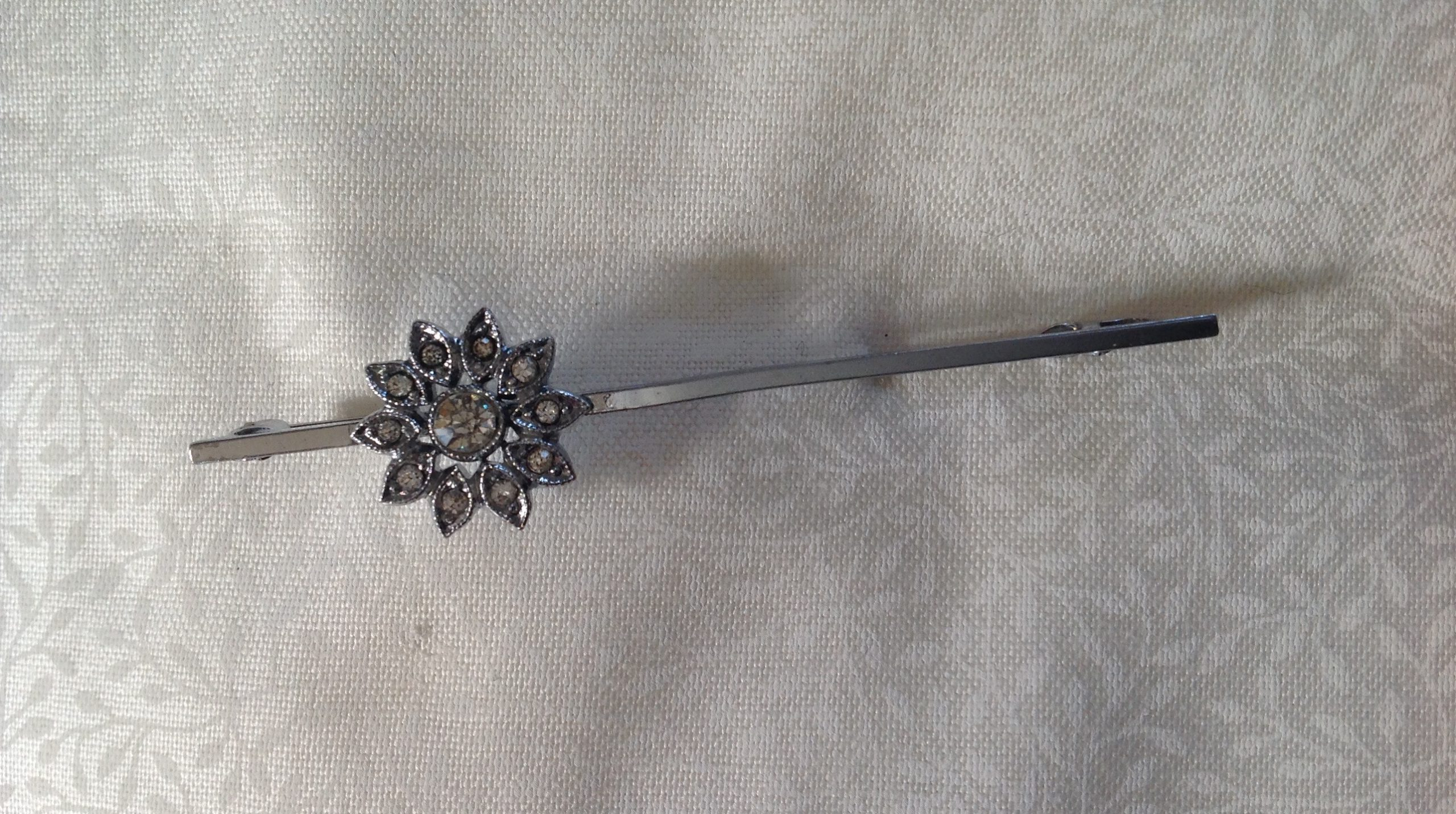 Vintage silvertone and offset clear past flower stock pin